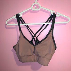 Pink and grey sports bra